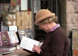 Whoman reading in front of the Book shop.
