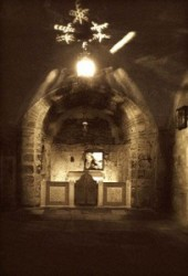 One can see the altar in the Chapel of Adam and the rock beneath the Golgotha. Church of the Holy Sepulchre is in Israel, Jerusalem old sity, Christian Quarter.