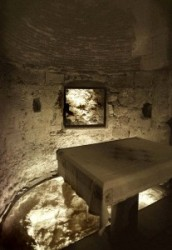One can see the altar in the Chapel of Adam and the rock beneath the Golgotha. Adam's  skull was buried here. When Jesus was crucified and his body was nailed, his blood was dripping down from the cro